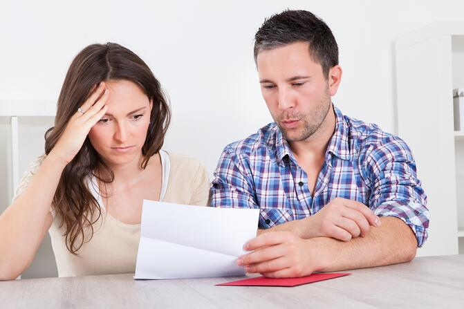 Couple looking at their utility bill